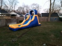 blue and yellow inflatable slide 399 mi