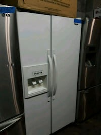Side by side refrigerator excellent condition  Baltimore, 21223