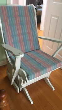 Teal, red, and blue cushioned glider chair