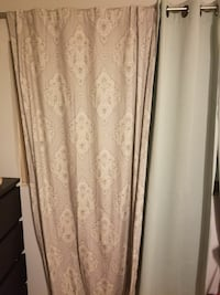 two brown and gray window curtains