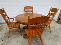 round brown wooden table with four chairs dining set 1200 mi