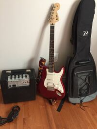 Red and white stratocaster electric guitar Guelph, N1C 1E4