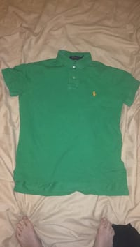 Green shirt with orange polo sign
