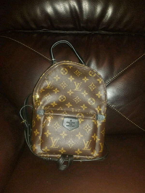 43a5bf4a4929 Used brown monogrammed Louis Vuitton leather backpack for sale in Staten  Island