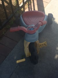 Toddler's red and blue plastic trike