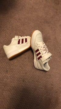 Pair of white-and-red adidas sneakers Falls Church, 22043