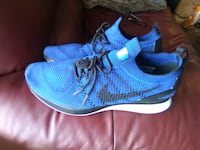 pair of blue Nike running shoes Calgary