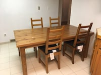 rectangular brown wooden table with four chairs dining set Mississauga