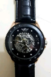 round black chronograph watch with black leather strap Barrie, L4M 2W3