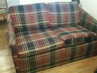 red, green, and white plaid fabric loveseat Elmhurst, 11373