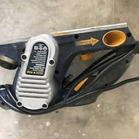black and yellow corded sander