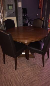 round brown wooden table with four chairs dining set Calgary, T2V 0Z3