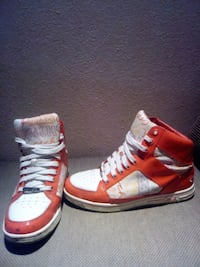 pair of red-and-white Coach high top sneakers Mississauga, L5N