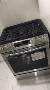 black and gray gas range oven SANANTONIO