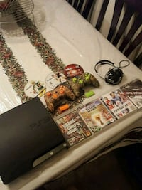 black Sony PS3 slim console with controller and ga Woodbridge, 22191
