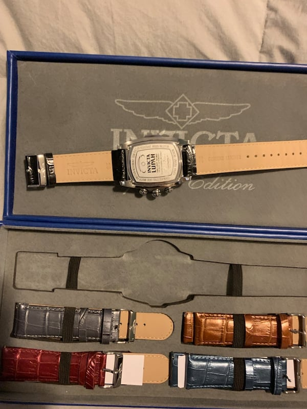 Men's Invicta grand Lupah watch with many bands. Need battery 4f2083d5-7b3f-4599-bdb5-96f80d2cc5ac