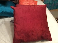 two red throw pillows