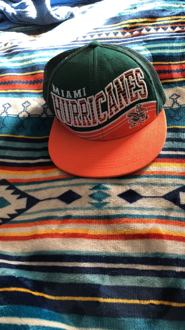 d90873fe052dd Used green and orange Miami Hurricans snapback cap for sale in Cleveland