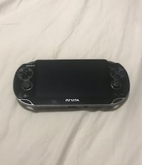 PsVita with games and cases Newmarket, L3X 3L1