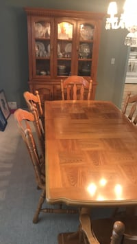 solid oak table w  leaf and  6 chairs. also 2 piece China cabinet, make offer  Orlando, 32806