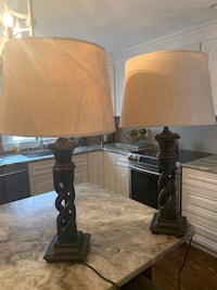 Two solid wood designer lamps