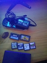 black Nintendo DS with game cartridges Summerville, 29485