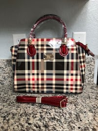 women's black, white, and pink Burberry leather handbag