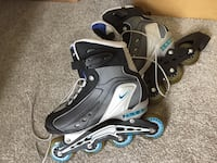 grey-and-black Nike inline skates women's size 8 (for 7-7.5 shoe size) 143 mi
