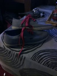 pair of gray-and-red Nike sneakers