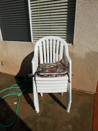 8 white chairs with 4 cushions and hand made cover