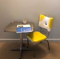 Vintage stainless steel table and yellow chair  Baltimore, 21211