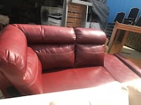 red leather sectional piece.  New Orleans, 70114