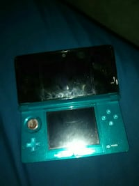 green and black Nintendo 3DS