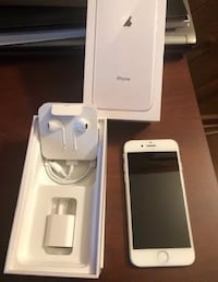 silver iPhone 8 with box, Power adapter USB cable, Lightning to USB cable, and EarPods with Lightning connector null