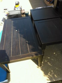 brown wooden coffee table and 2 end tables