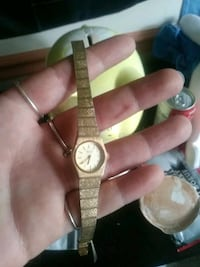 round gold analog watch with link bracelet Burnaby, V5A 1M9