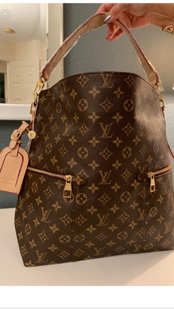 d0ba9b565f86 Used Brown louis vuitton monogram leather backpack for sale in ...