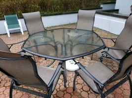 black metal framed glass top patio table set