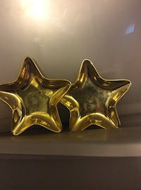 2 golden decorative candle holders