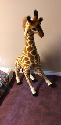 brown and white giraffe plush toy