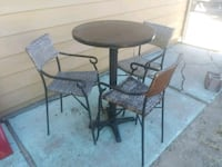round black metal table with four chairs patio set Nampa, 83651