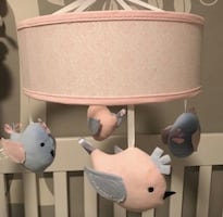 Blue and pink baby mobile with birdd