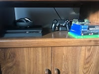 black Sony PS4 console with controller and game cases Woodbridge, 22191