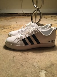 Pair of white adidas superstar in box