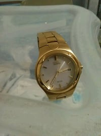 round gold analog watch with gold link bracelet Spring Hill, 34610