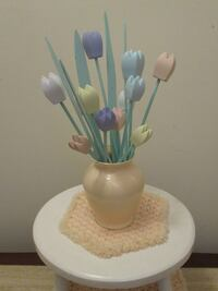 Pastel colored wooden tulips in vase
