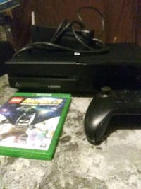 black Xbox One console with controller and game case 375 mi