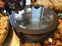 round glass top table with brown wooden base 2281 mi
