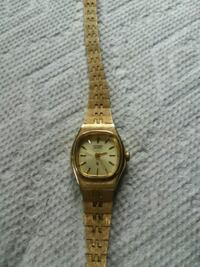 round gold analog watch with gold link bracelet Harpers Ferry, 25425