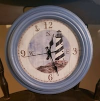 Lighthouse design clock, blue rim